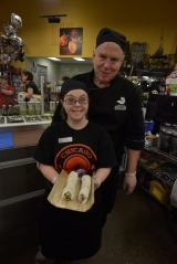 Erin Moore being taught had to make sushi by Mark with SnowFox Sushi at Kroger Hamilton Rd and Morse Rd, Columbus, OH